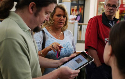 Consumer using iPad