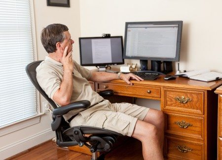 Steve Heap / Shutterstock | http://www.shutterstock.com/pic-105854495/stock-photo-senior-caucasian-man-working-from-home-in-shorts-with-desk-with-two-monitors.html?src=946e90e3445e5fc9e410a3eb5ed1bab3-1-11