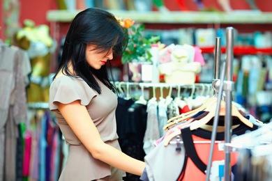 Olesia Bilkei / Shutterstock | http://www.shutterstock.com/pic-120928828/stock-photo-young-elegant-woman-shopping-in-clothes-store.html?src=NBtQmI7NgdUKEiGRRPox9Q-1-2