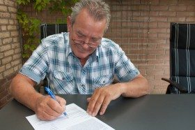Semmick Photo / Flickr | http://www.shutterstock.com/pic-108368768/stock-photo-charming-dutch-male-senior-citizen-with-a-smile-on-his-face-signing-a-legal-document-in-his.html?src=4424f57f4b1aa0a32e660ef173405d84-14-6