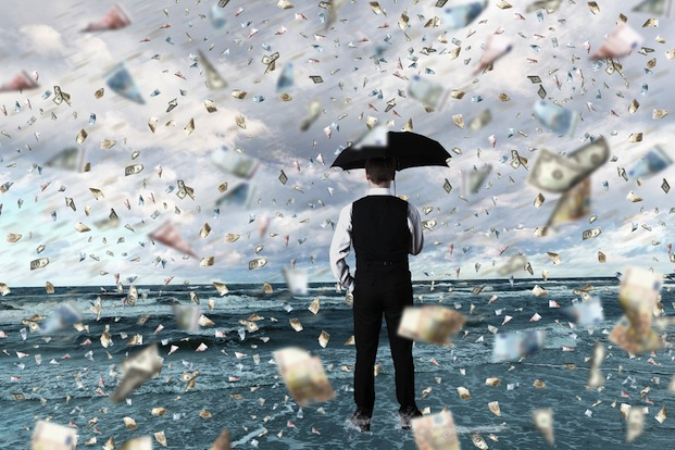 Sergey Nivens / Shutterstock | http://www.shutterstock.com/pic-108174599/stock-photo-young-businessman-standing-with-umbrella-under-money-rain.html