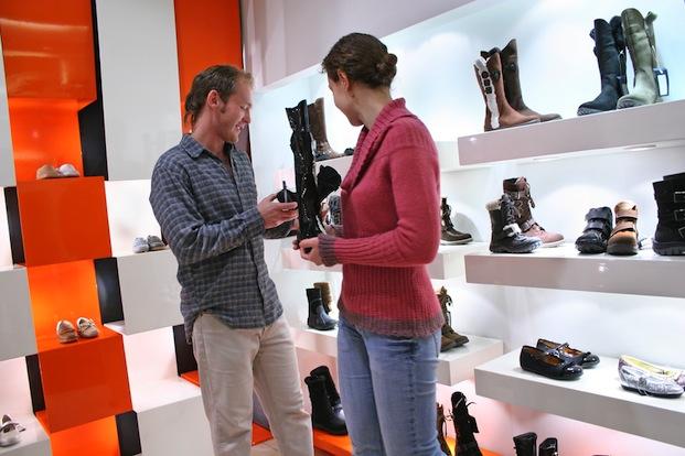 Pavel L Photo / Shutterstock | http://www.shutterstock.com/pic-2238047/stock-photo-couple-in-shoes-shop.html?src=85C6A1A0-9BCE-11E2-965D-E8C071D9A14D-1-4