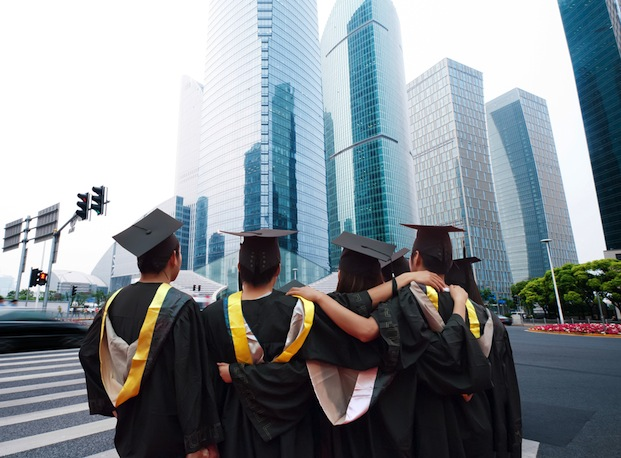 Gui Jun Peng / Shutterstock | https://www.shutterstock.com/pic-112563773/stock-photo-group-of-graduates-will-face-the-modern-city.html