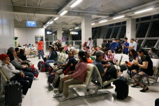 passengers waiting for delayed flight