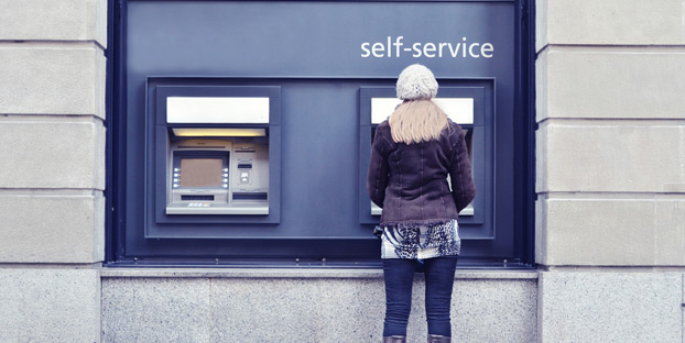 Several banks, including U.S. Bank, PNC and Wells Fargo now allow you to make ATM check deposits without needing an envelope. Image via Shutterstock