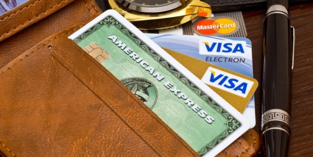 Visas and MasterCards may soon be accepted by Costco. Shutter tock