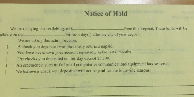 Some banks put their deposit-hold policies on the back of the deposit slips. This one is from First American International Bank.