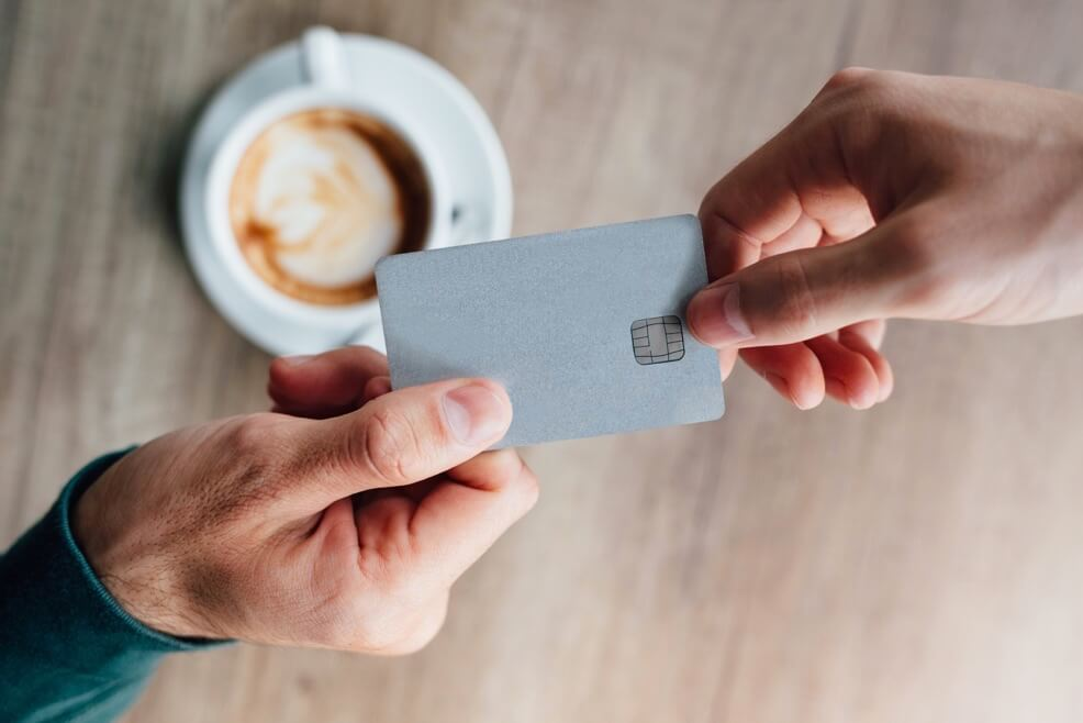 Image Credit   https://www.shutterstock.com/pic-415773415/stock-photo-closeup-of-man-in-cafe-giving-credit-card-to-waiter.html?src=q-0d-DdBMK7t8XjsVWH7PA-1-49