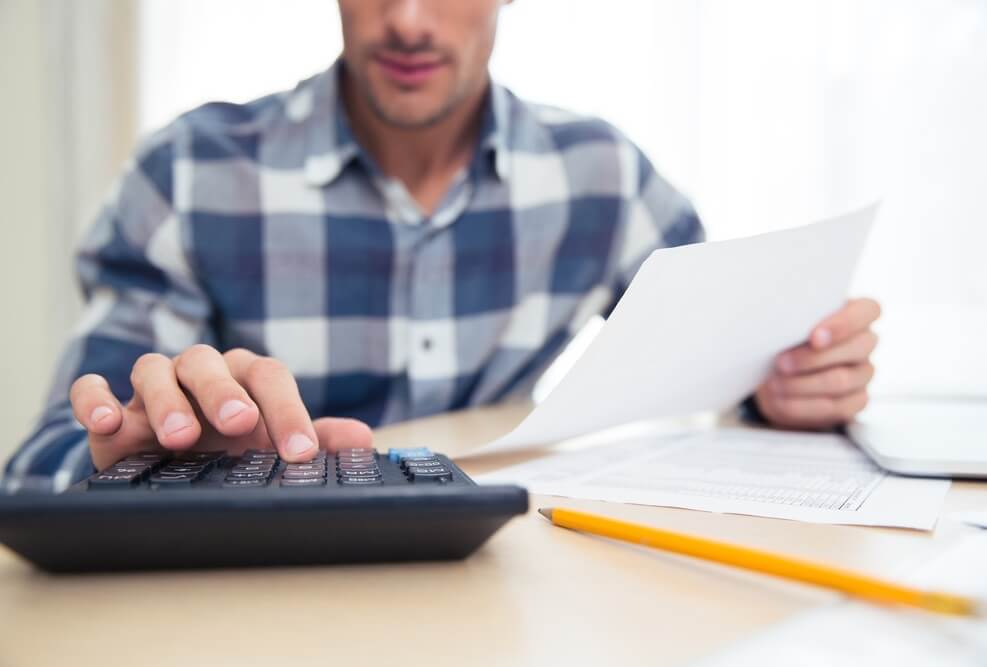 Image Credit | http://www.shutterstock.com/pic-321796418/stock-photo-closeup-portrait-of-a-man-with-calculator-checking-bills-at-home.html?src=ft3mfMXPX3Jhqc1q1DGDVg-2-6