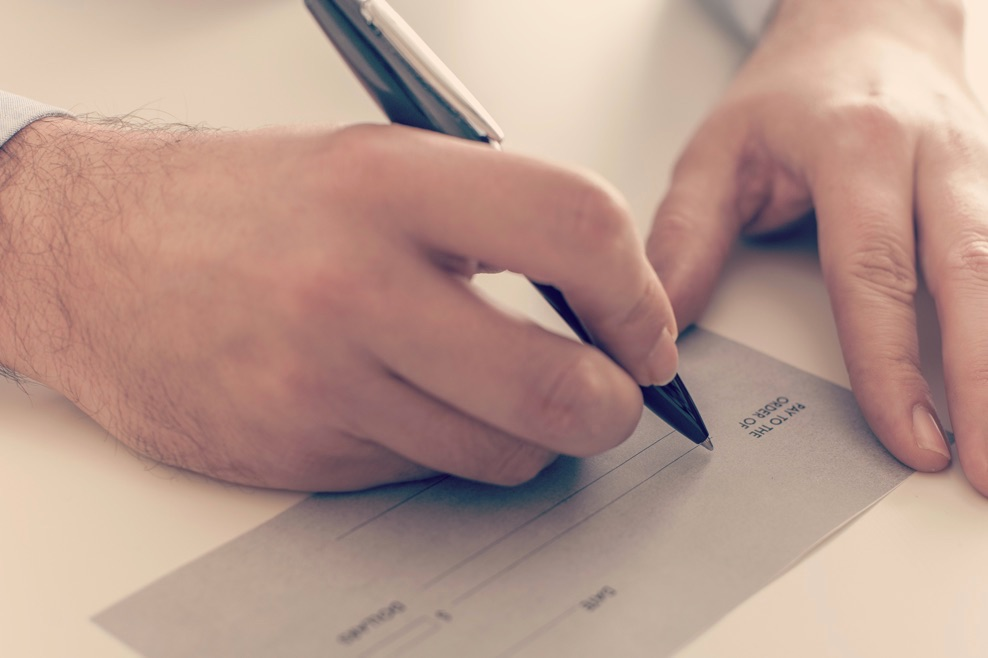 Image Credit   https://www.shutterstock.com/pic-372711070/stock-photo-close-up-of-a-businessman-writing-a-payment-check.html?src=pp-same_artist-311226329-2&ws=1